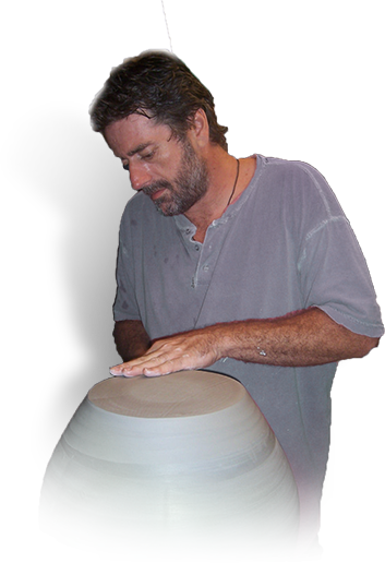 Photo of Miles Roberts at the pottery wheel.